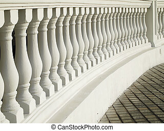 White Balustrade Pattern - A white painted balustrade with a...