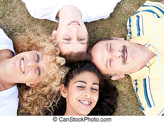 Happy family of four on grass