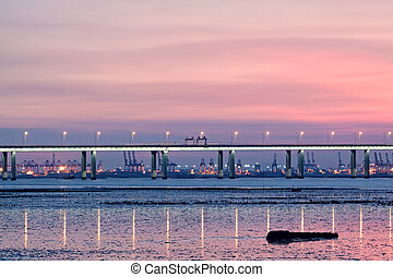 sunset in hongkong and highway bridge and container pier