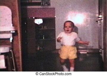 Little Boy Walking Inside (1963) - A cute little boy wearing...