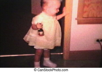 Little Boy Wearing Dress 1963 - A cute little boy wearing a...