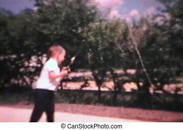 Little Boy With New Fishing Rod - A little boy tries out his...