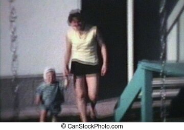 Mom And Little Boy Outside (1963) - A proud mom and her...