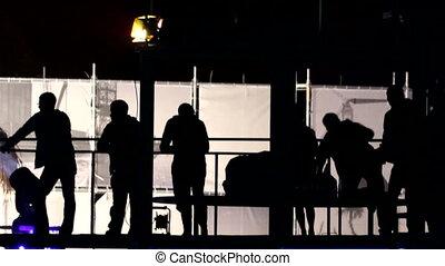 Silhouette dancing people
