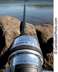Fishing pole closeup at the lake