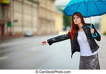 Girls Hitchike - redhead girls with umbrella hitch-hiking at...