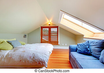 Attic bedroom with low ceiling and green walls