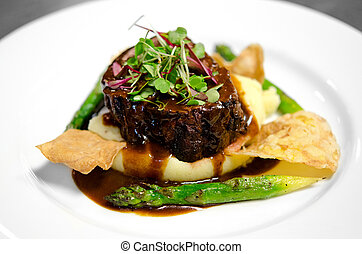 Gourmet filet on bed of mashed potatoes - Image of a steak...