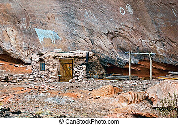 Navajo Indian paintings and dwelling