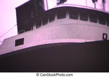 Ship Passes Through Canal 1964 - A huge ship goes through...