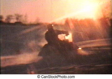 Snowmobiling At Dusk (1975 Vintage) - Two friends enjoy some...