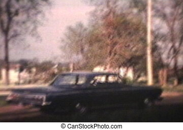 Suburban Scene 1964 - Vintage 8mm - An old car is parked in...