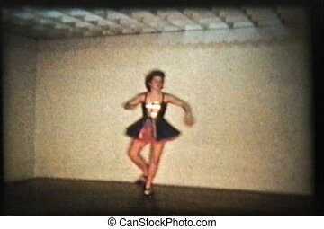 Tap Dancing - A beautiful teenage girl wearing a pretty...