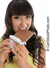 Beautiful girl eating decadent chocolate bar - Closeup of a...