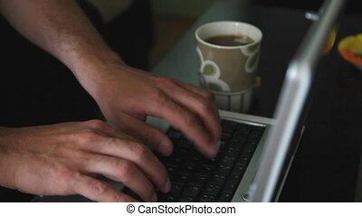 man typing computer 2