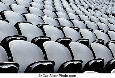Seats on the stadion - A rows black seats on the stadion The...