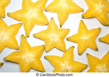 Starfruit slices - Lots of carambola slices forming a...