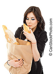 Female paper bag bread - Beautiful female holding shopping...
