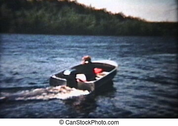 Woman Driving Motorboat 1960 - A beautiful red headed woman...
