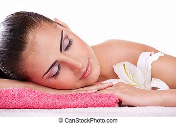 brunette spa woman in towel on head