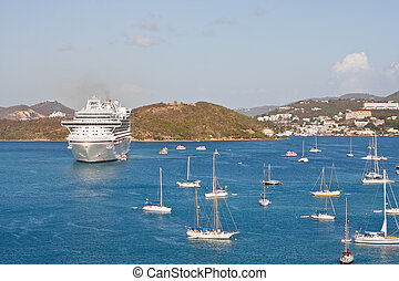 White Cruise Ship in Bay with Many Sailboats - Blue water...