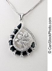 Close up of diamond pendant isolated over white background