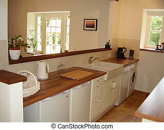 Kitchen Interior - View of a kitchen with a section of wall...