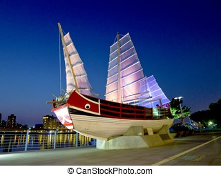 a taiwan ancient ship shows in a public place in night