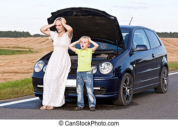 Car trouble and stress - Young mother with two children...