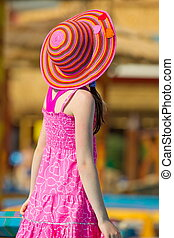 Girl in colorful sun hat - Young girl in pink dress and...