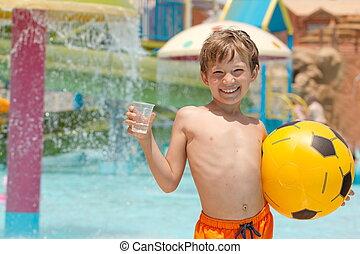 Smiling boy at swimming pool