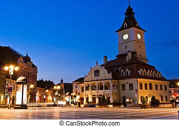 Brasov Council Square at twilight - Transylvania, Romania -...