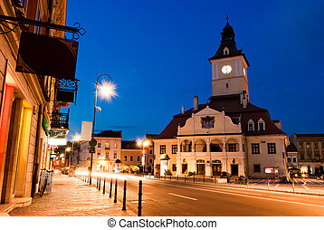 Brasov Council Square at twilight - Transylvania, Romania -...