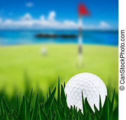 Golf ball on a golf course with a green and the beach in the background