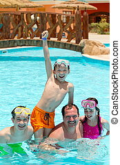 Kids and father in pool - Three kids with father in a...