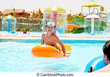 Children playing in pool - Happy young boys playing on...