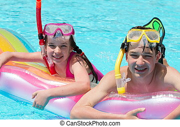 Children in Pool with Goggles