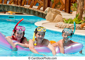 Children in swimming pool - Three children in swimming pool...