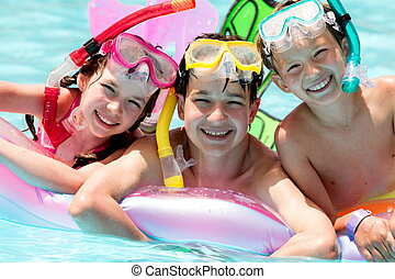 Happy children in pool - Happy young brothers and sister...