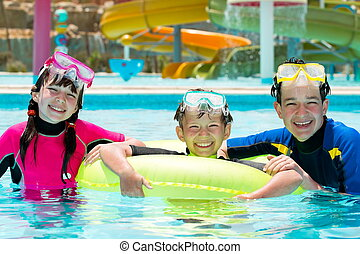 Summer holiday - Three happy siblings wearing goggles and...