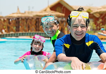Brothers and sister in pool