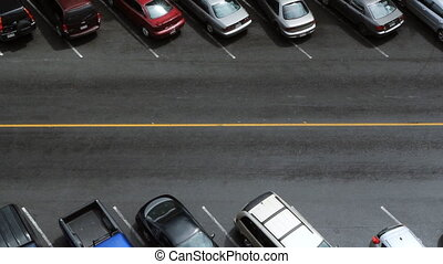 Street. Two cars pass. - Aerial view of downtown street. Two...