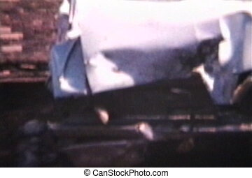 Wrecked Car (1962 - Vintage 8mm) - A slow pan of a wrecked...
