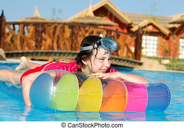 Girl on lilo in pool