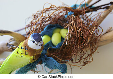 Bird with Easter eggs.
