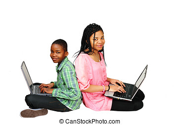 Kids study on computer - Two beautiful kids studying on...