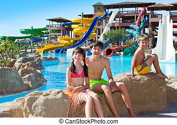 Kids by the water slides - Happy kids at the water slides...