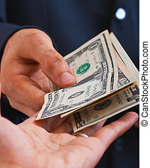 Receiving Dollars For A Sale Or Wages - Man Receiving...