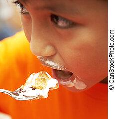 Messy Kid Eating Cream Cake Dessert