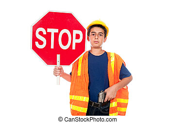 Child construction worker - A boy directs traffic using a...